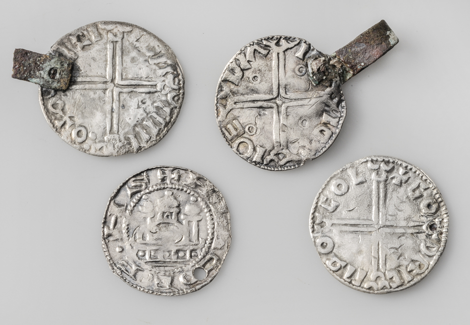 Coin-pendants Silver All of the coins were used as pendants. They are of different origin. Grave find, Kylver, Stånga, Gotland, Sweden. SHM 13436